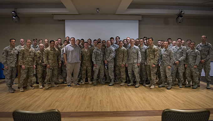 Airmen from the 38th Rescue Squadron pose for a photo with Retired Tech. Sgt. Keary Miller after a presentation, March 3, 2017, at Moody Air Force Base, Ga. Miller shared his story of the Battle of Roberts Ridge during the presentation. His goal was for the 38th RQS Pararescuemen to understand that what they do during their training has an impact down the road and they need to perform at a standard in order to be successful overseas. (U.S. Air Force photo by Airman 1st Class Lauren M. Sprunk)