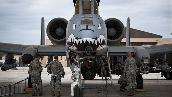 Airmen from a Wing Inspection Team, left, and Tech. Sgt. Chase Williams, 23d Maintenance Group Quality Assurance inspector, examine an A-10C Thunderbolt II, March 23, 2017, at Moody Air Force Base, Ga. Two WITs visited Moody in order to assess the 23d Maintenance Group's QA section. During their visit, the WIT inspected nearly 30 different QA programs, with an added focus on corrosion control. (U.S. Air Force photo by Airman 1st Class Lauren M. Sprunk)