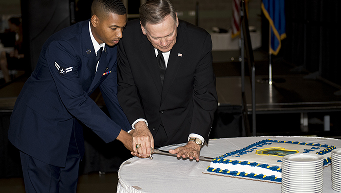 Airman 1st Class Christopher Smith, 823rd Base Defense Squadron fire team member, and Retired chief of staff Gen. John Jumper, perform a cake cutting ceremony, during the 820th Base Defense Group's 20th Anniversary Celebration, March 29, 2017, in Valdosta, Ga. Jumper was a command pilot with more than 5,000 flying hours, including 1,400 combat hours. The celebration included an 820th BDG capabilities demo, a reenlistment ceremony and a formal dinner. (U.S. Air Force photo by Airman 1st Class Daniel Snider)