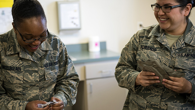 Staff Sgt. Jasmine McClellan, left, 23d Aerospace Medicine Squadron (AMDS) Public Health Flight NCO in charge of deployment medicine, and Senior Airman Evelyn Alvarado, 23d AMDS Public Health Flight meal, ready to eat (MRE) program manager, examine the content on their MREs during an MRE open-package inspection, April 6, 2018, at Moody Air Force Base, Ga. Airmen from Public Health examine the MREs for defects and overall quality and determine whether they'll be utilized here, at other bases or to condemn the batch. Public Health monitors more than 8,400 MREs yearly to ensure they are safe and fit for consumption, so as to maintain a healthy fighting force. (U.S. Air Force photo by Airman 1st Class Erick Requadt)
