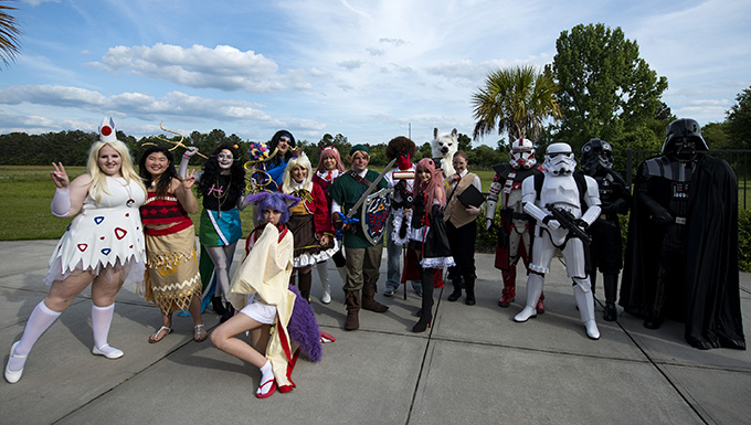 Cosplayers pose for a photo while at Tiger Con, April 14, 2018, in Valdosta, Ga. Tiger Con was a convention, open to Moody residents and the local community, geared toward giving pop culture enthusiasts a chance to dress and role play as their favorite movie, TV show or comic characters. The event included a costume contest, an anime themed café, pop-culture artist panels along with shopping vendors and a guest appearance of veteran voice actor Richard Epcar, who's known for portraying Raiden in the video series Mortal Kombat. (U.S. Air Force photo by Airman 1st Class Erick Requadt)