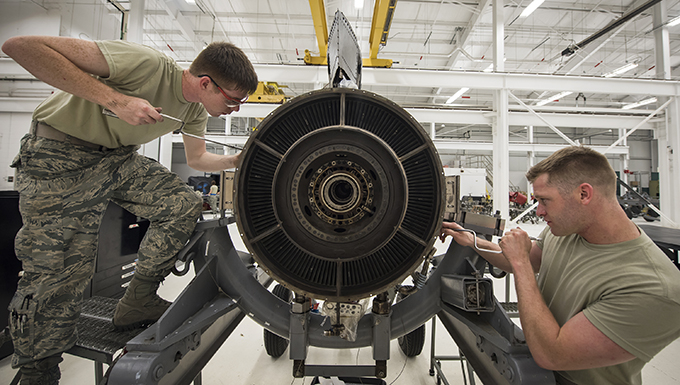 Staff Sgt. Maximillion Bause, right, and Airman 1st Class Austin Maurer, 23d Maintenance Squadron (MXS) aerospace propulsion technicians, repair a Turbo-Fan(TF)-34 engine, May 16, 2018, at Moody Air Force Base, Ga. The 23d MXS propulsion flight's mission is to ensure that the A-10C Thunderbolt II TF-34 engine is in satisfactory condition before it's even installed on the aircraft. This flight is responsible for the overall upkeep and maintenance of all TF-34 engines for the Air Force's largest operational A-10 fighter group. (U.S. Air Force photo by Airman 1st Class Eugene Oliver)