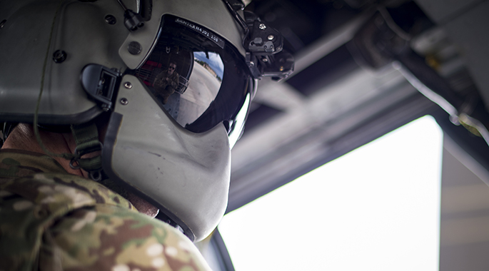 A special missions aviator from the 41st Rescue Squadron performs a systems check prior to flying in an HH-60G Pave Hawk, May 17, 2018, at Moody Air Force Base, Ga. Airmen conduct routine training missions in the airspace surrounding Moody to remain current on their tactics and procedures. While helping pilots remain proficient, training also gives crew chiefs and maintainers the opportunity to remain proficient at launching and maintaining the aircraft. (U.S. Air Force photo by Senior Airman Janiqua P. Robinson)