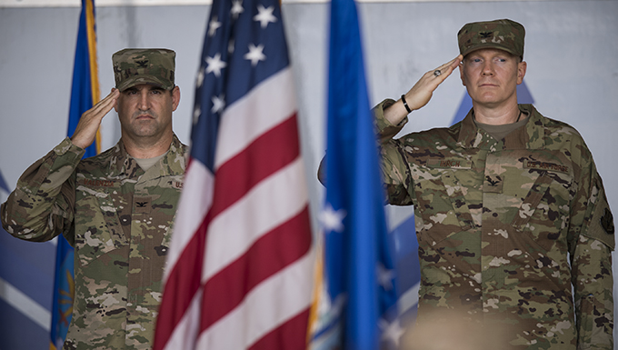 Col. Jeffrey Valenzia, left, outgoing 93d Air Ground Operations Wing commander, and Col. Paul Birch, incoming commander, salute the color guard at the AGOW change of command ceremony, May 23, 2018, at Moody Air Force Base, Ga. The event marks the beginning of a new regime as Birch becomes the 7th commander of the Wing and its battlefield Airmen. (U.S. Air Force photo by Staff Sgt. Ryan Callaghan)