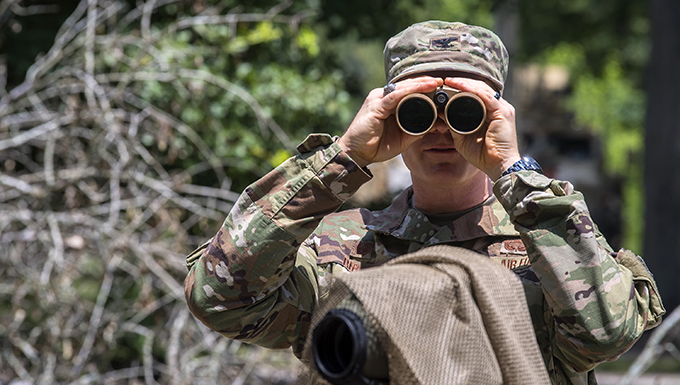 Col. Paul Birch, 93d Air Ground Operations Wing (AGOW) commander, looks through binoculars during an immersion tour, June 25, 2018, at Moody Air Force Base, Ga. Birch toured the 820th Base Defense Group to gain a better understanding of their overall mission, duties and comprehensive capabilities. Prior to taking command of the 93d AGOW, Birch was the commander of the 380th Expeditionary Operations Group at Al Dhafra Air Base, United Arab Emirates. (U.S. Air Force photo by Airman 1st Class Eugene Oliver)