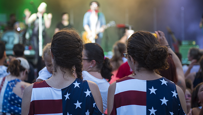 Participants watch the country band Thompson Square perform at a concert during the Patriot Festival, July 3, 2018, at Moody Air Force Base, Ga. Team Moody hosted the free event to allow Airmen and their families an opportunity to take some time away from the mission and enjoy a Fourth of July experience. The event consisted of live music, food trucks, family fun and a fireworks show. (U.S. Air Force photo by Airman 1st Class Erick Requadt)