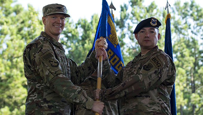 Col. Paul Birch, left, 93d Air Ground Operations Wing commander, and Col. Benito Barron, 820th Base Defense Group (BDG) commander, pose for at photo during a change of command ceremony, July 12, 2018, at Moody Air Force Base, Ga. The ceremony represents the formal passing of responsibility, authority and accountability of command from one officer to another. Barron, who recently relinquished his duties as the Chief of the Homeland Defense and Protection Division for Headquarters United States Northern Command, will now command the 820th BDG. The 820th BDG is the Air Force's only unit specifically designed to provide fully integrated defense operations. (U.S. Air Force photo by Airman 1st Class Erick Requadt)